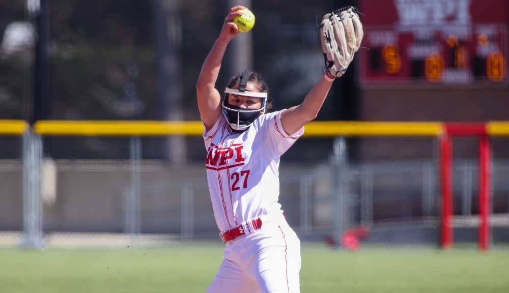 A member of the WPI softball team delivers a pitch.