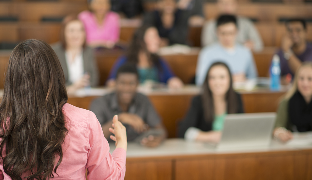 Stock photo of a woman professor in a classroom
