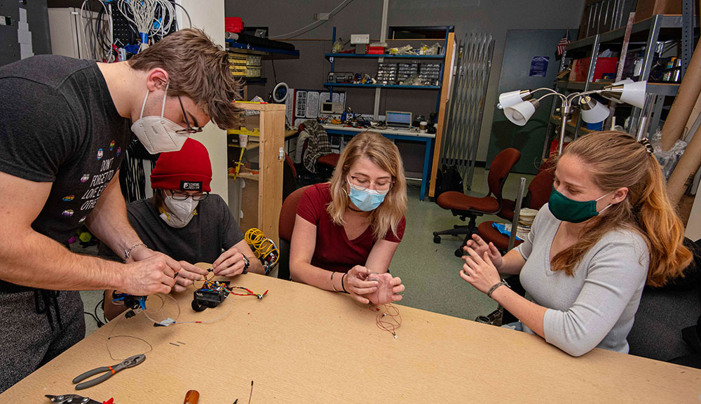 Assembly of the latest prototype of the partial hand prosthesis at WPI's Popovic Labs.