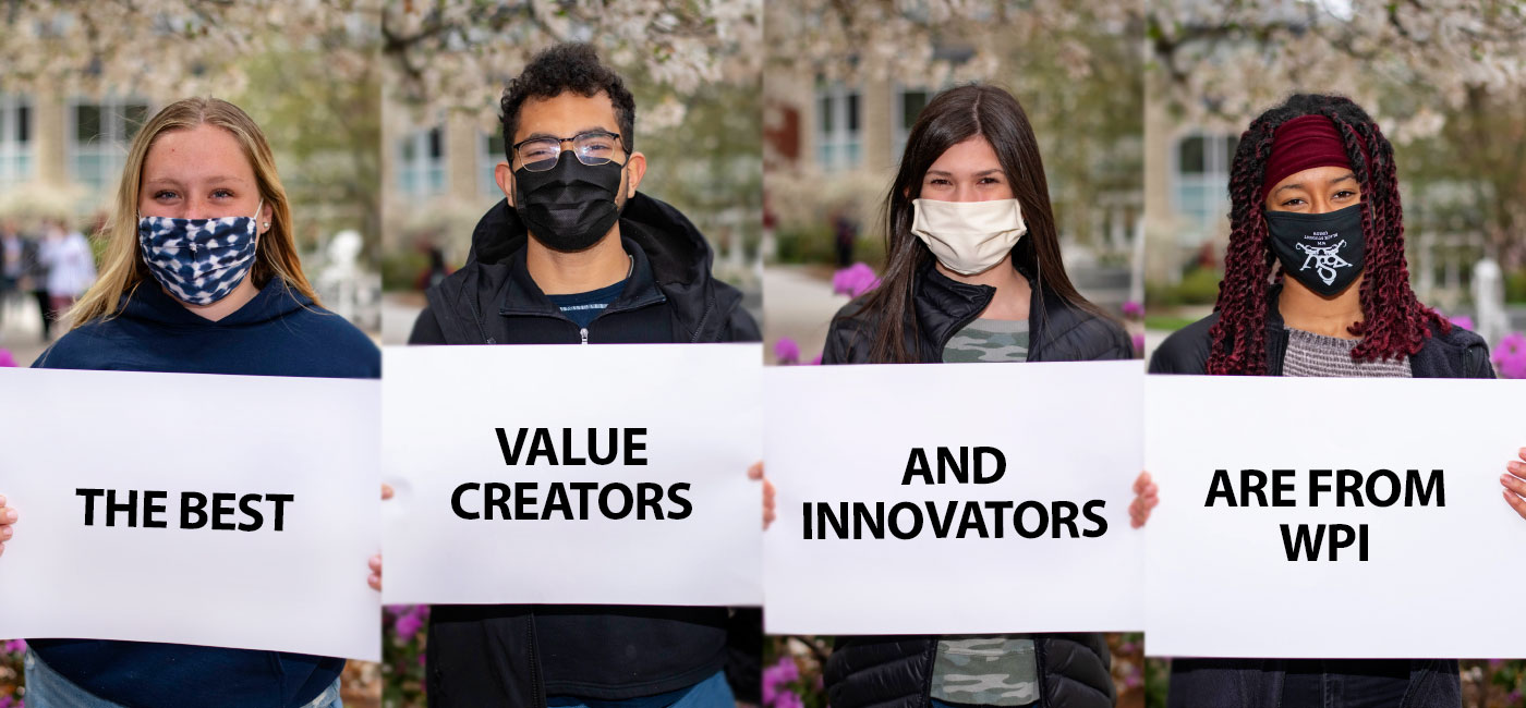 Four students holding signs that say The Best Value Creators and Innovators Are at WPI