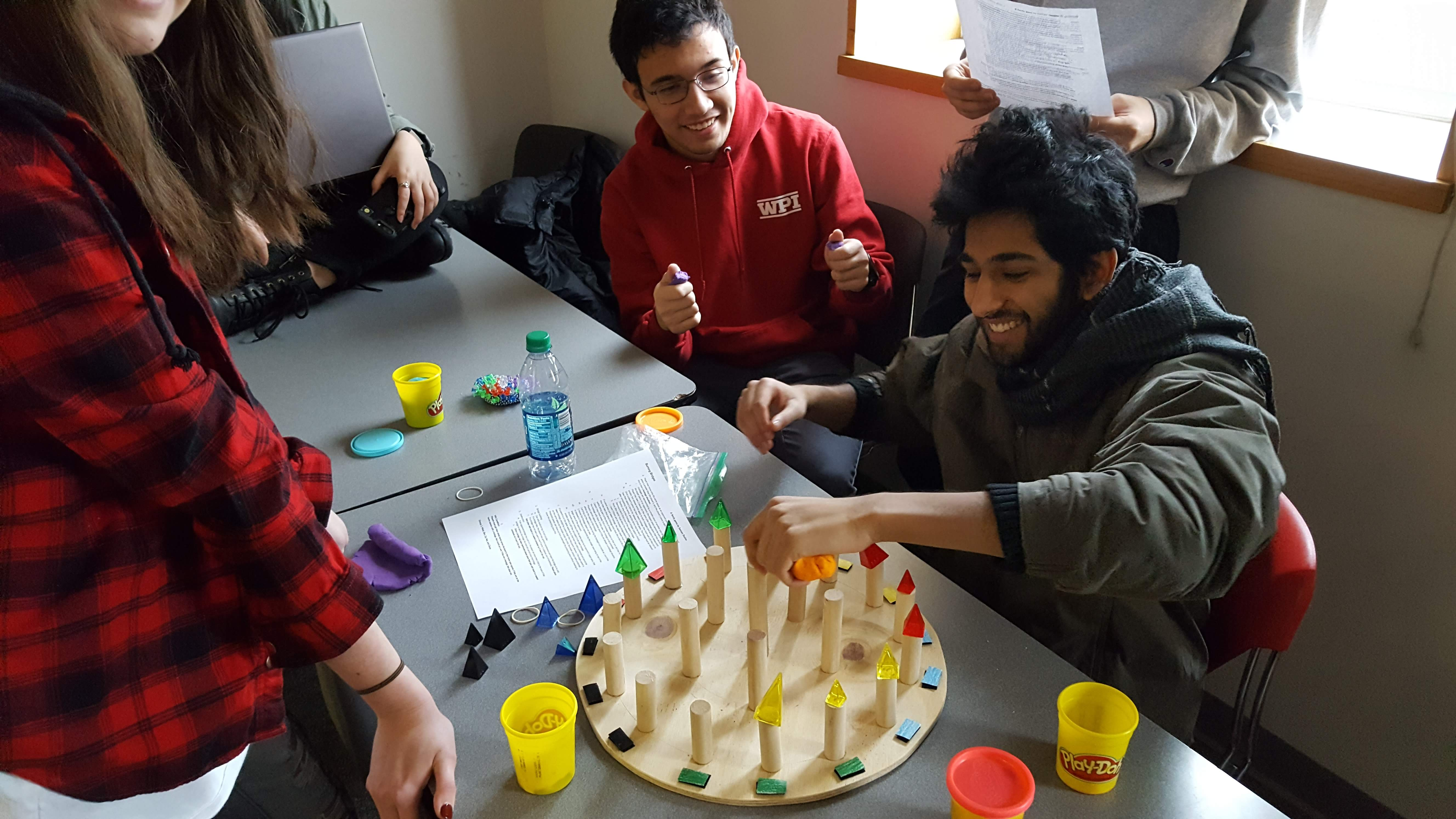 IMGD students playtesting a paper prototype of a board game.