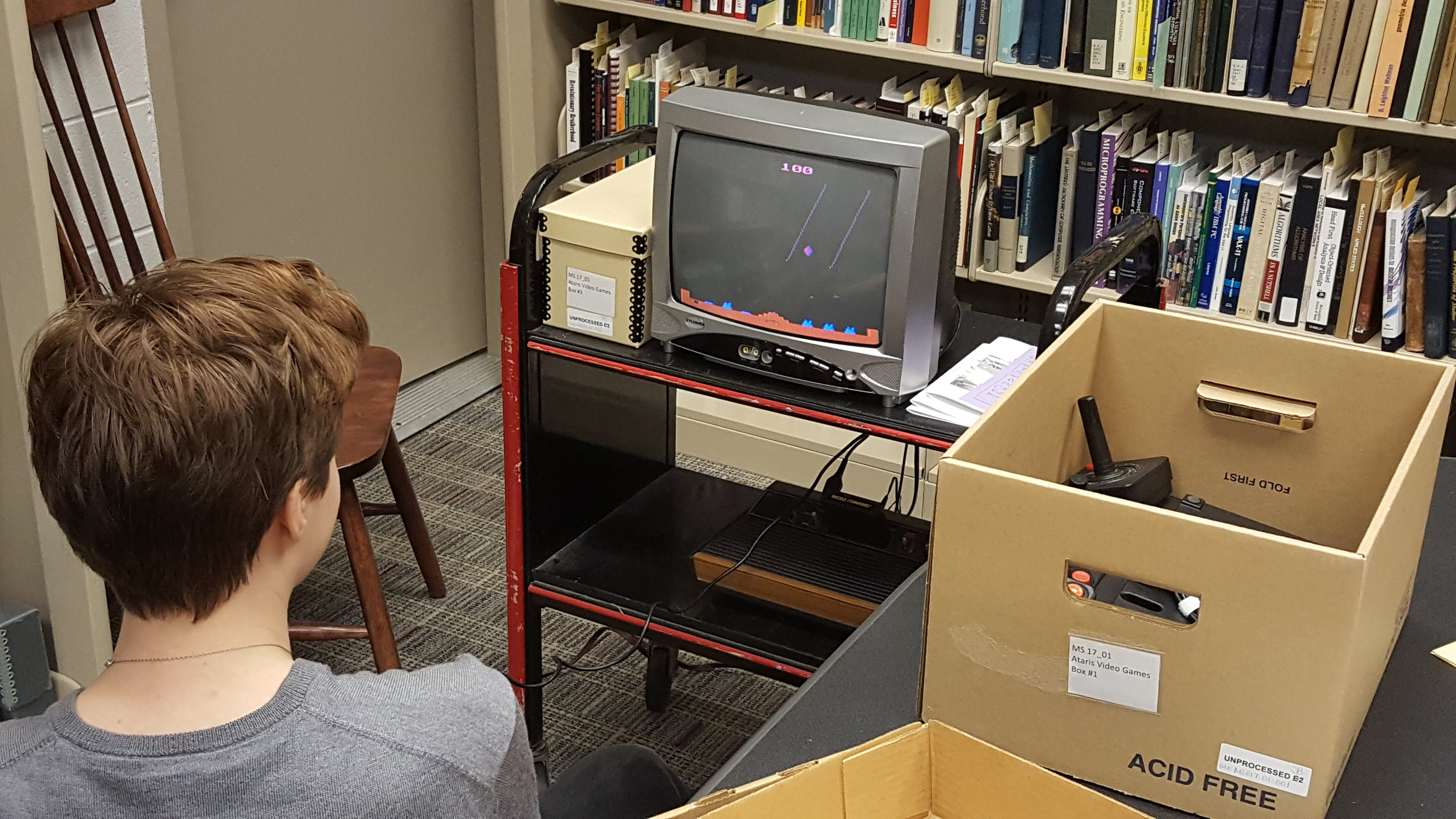 A student playing a game from IMGD's video game archive.