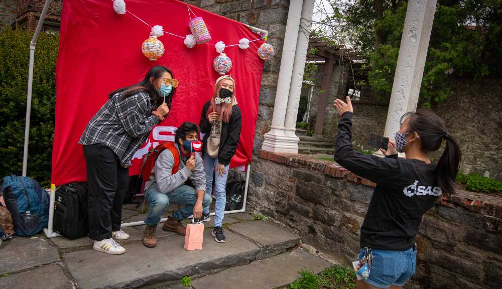 Students participate in a photo booth during the Pan-Asian festival held on Higgins Lawn.