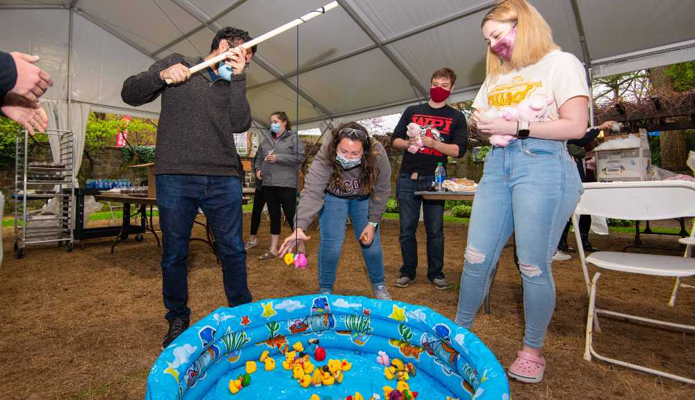Students engage in a fishing activity as part of this year's QuadFest.