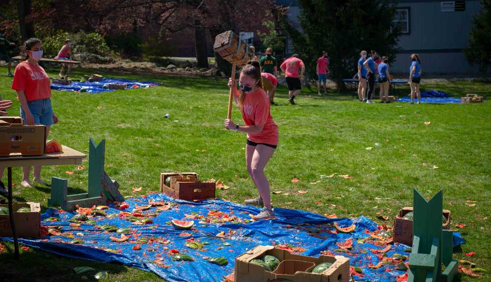 A student smashes a watermelon as part of the annual Watermelon Bash charity event.