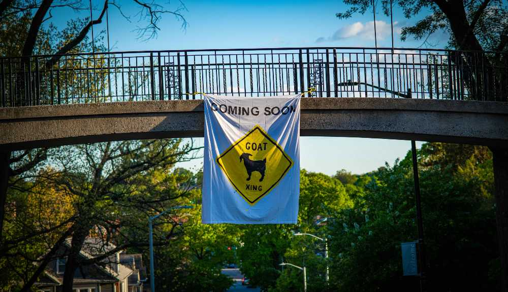 A photo of a banner hanging on Earle Bridge that reads