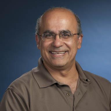Joe Sarkis in a brown shirt alt