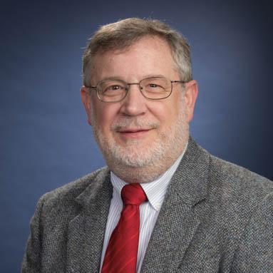 Steve Kmiotek in a blazer and red tie alt