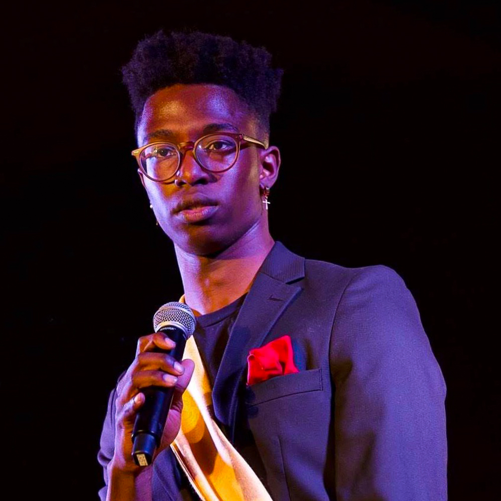Kristophe Zephyrin holds a mic during a past BSU fashion show.