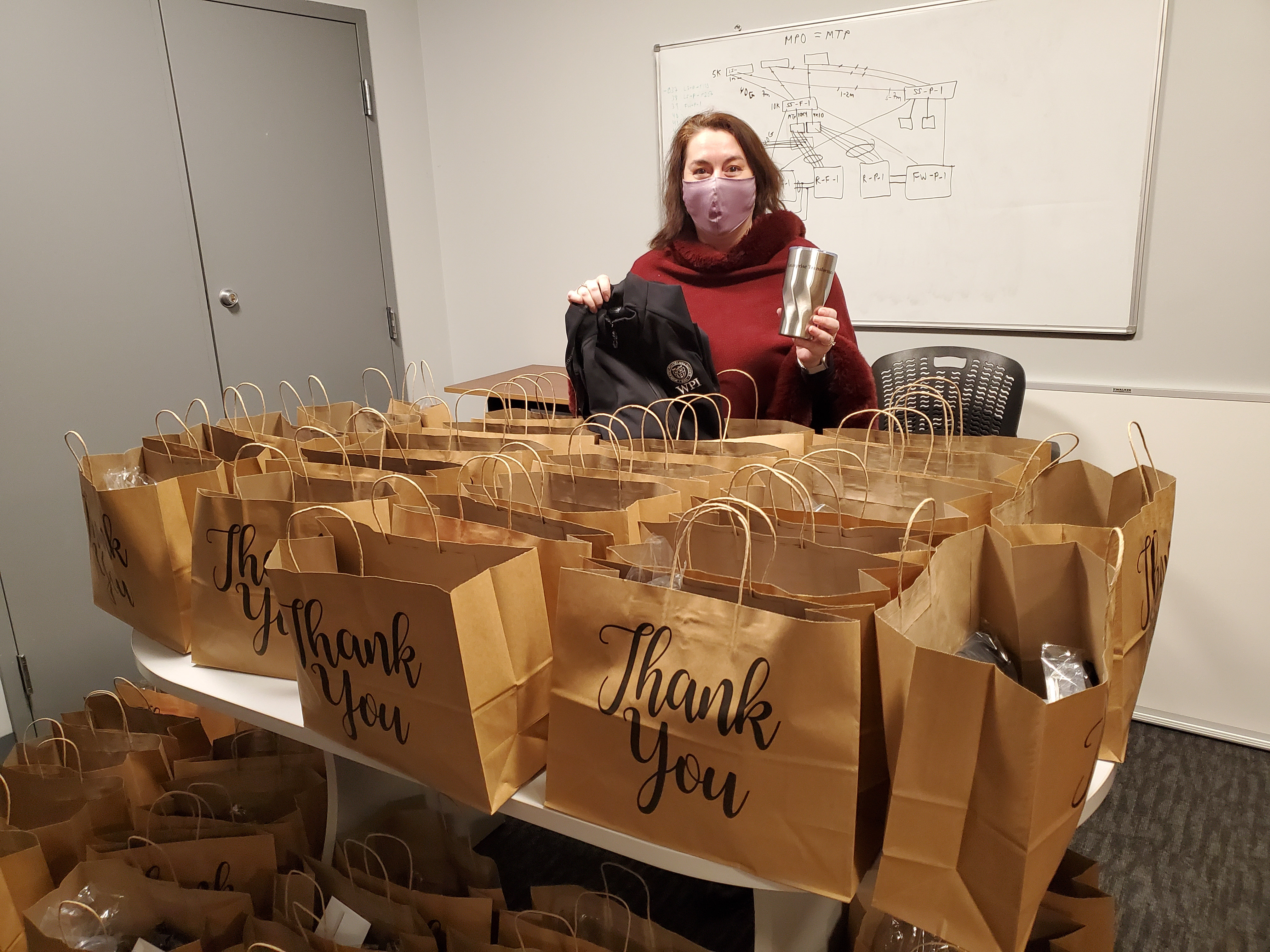 Woman posing with gift bags  alt