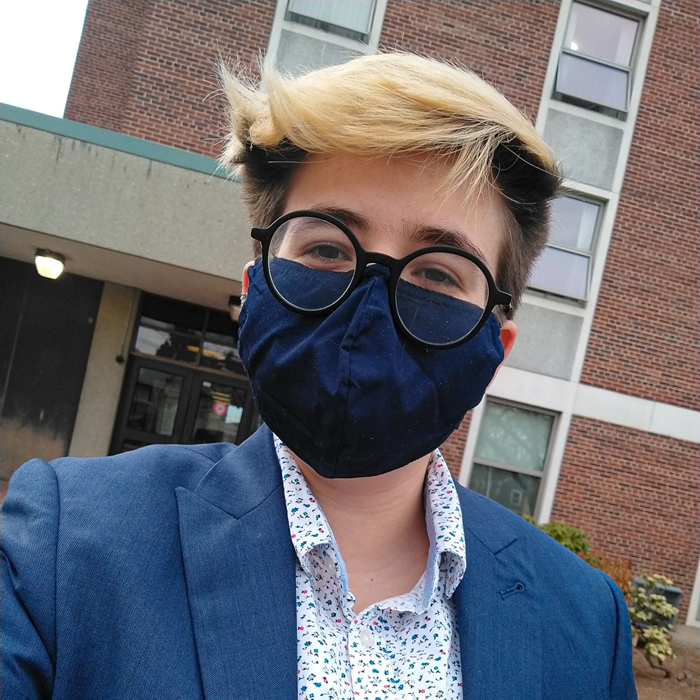 Rosana Pochat wears a mask on campus while taking a selfie.