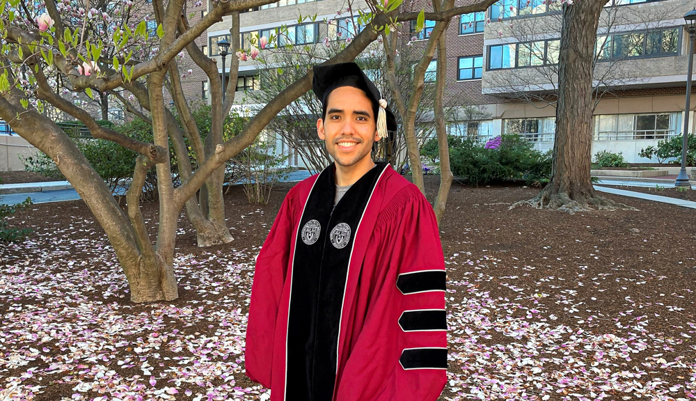 Diego Vargas Blanco smiles in his Commencement robes.