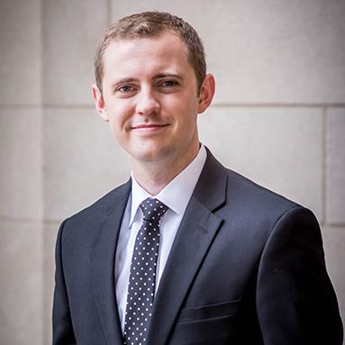 Joshua Rohde in a suit alt