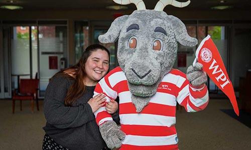 WPI undergraduate student with mascot