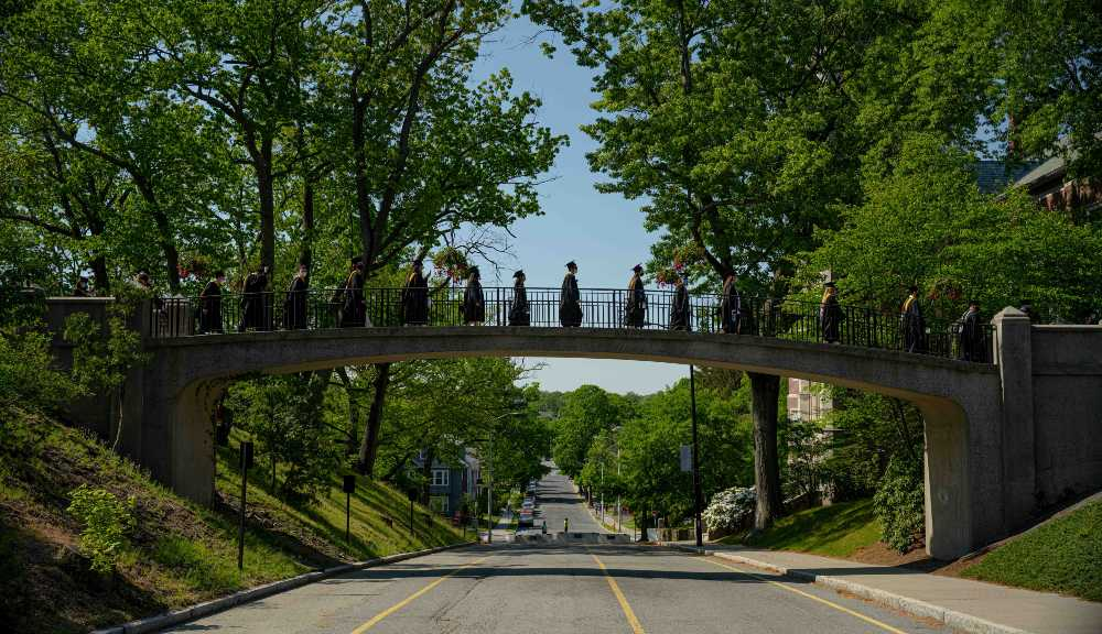 Students cross Earle Bridge on their way to Commencement.