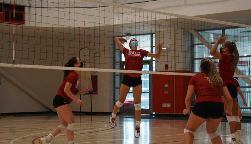 Members of the volleyball team practice in the Sports & Recreation Center.
