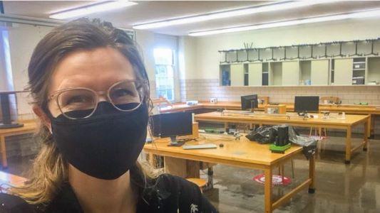 L Dana wearing a black face covering/mask