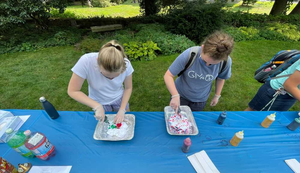 Students participate in a tie-dye event on Higgins Lawn.
