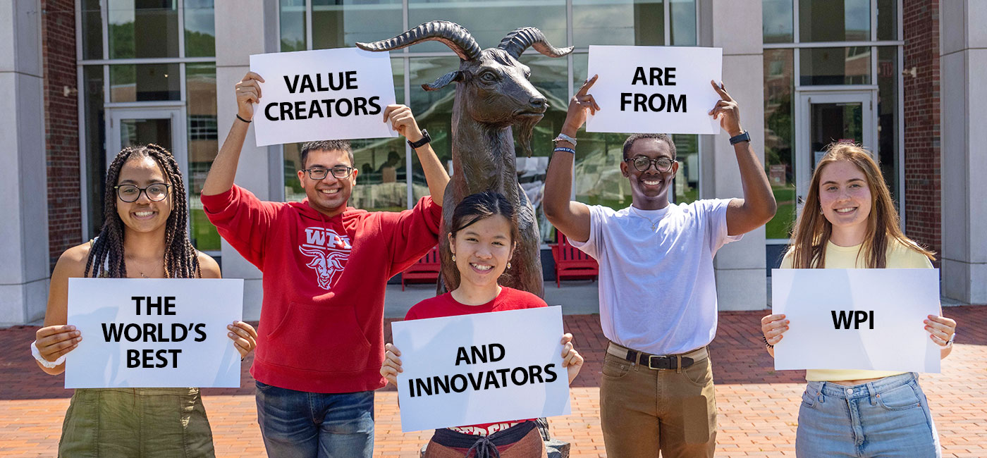 five students holding signs that say The world's best value creators and innovators are from WPI