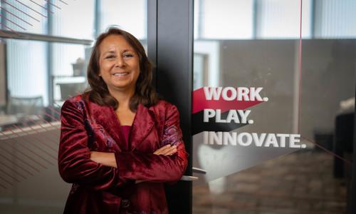 Rosana Garcia wearing a red blazer in the I&E Center