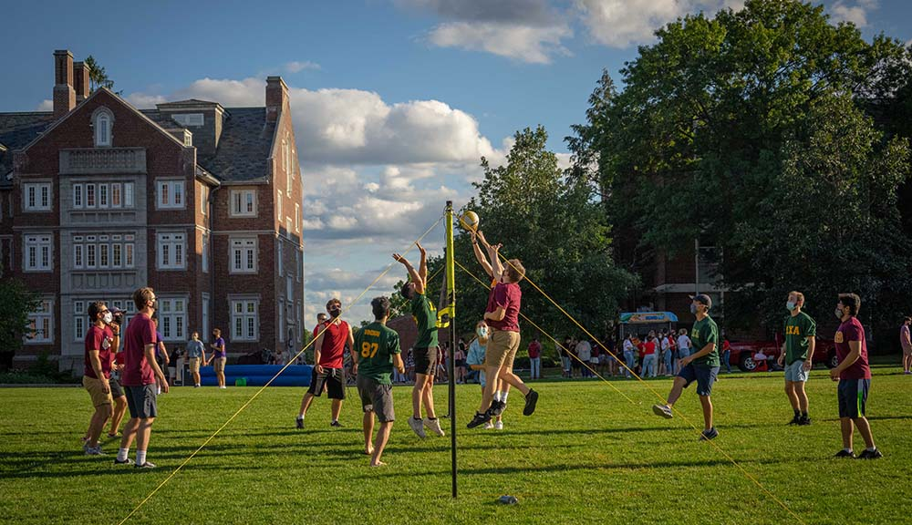Fraternity brothers play a game of volleyball on the Quad.