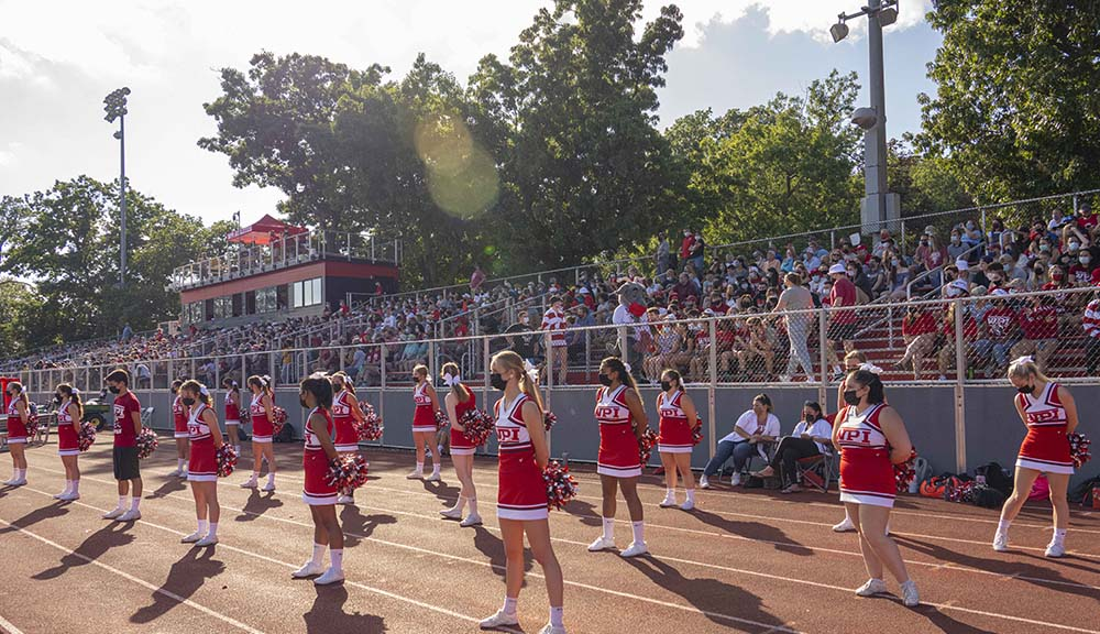 The cheerleading team gets ready to hype up the crowd during the Homecoming football game.