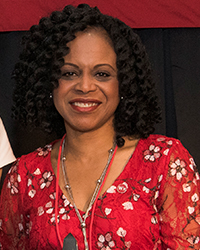 Debora Jackson headshot, red top