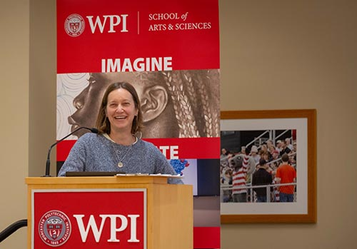 WPI faculty member at podium