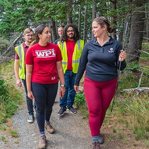 Group of WPI students walking in woods