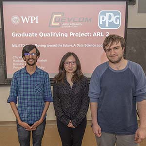 WPI graduate students in front of screen