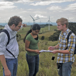 Students working at a Global Project Centers with windmills in the background