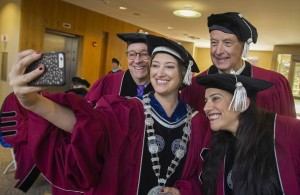President Leshin has some selfie fun with David Schwaber, left, Warner Fletcher and Reshma Saujani.