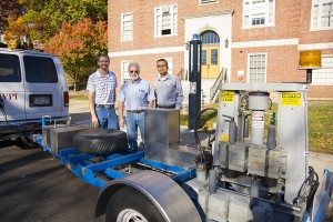 PhD student Ryan Worsman, left, Donald Pellegrino, CEE lab manager, and Rajib Mallick with a falling weight deflectometer on a trailer.