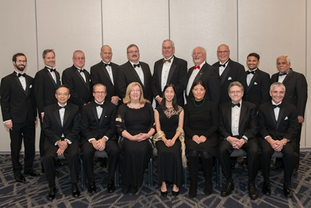Lados (seated, third from right) with other members of the ASM board of directors in a photo taken during at Materials Science & Technology 2018
