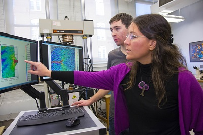WPI professor Diana Lados analyzes test results on an aircraft aluminum alloy in Washburn labs.