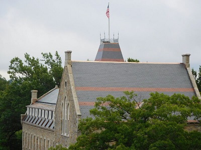 The restored slate roof on Boynton Hall, with its characteristic red banding.