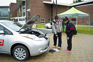 Visitors check out the charging system on the Nissan Leaf during last year's show.