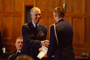Lt. Col. Michael L. DeRosa, Detachment 340 AFROTC commander, offers his congratulations.