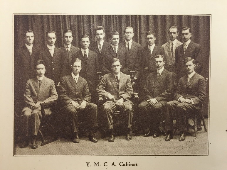 Yi Chi Mei seated with other YMCA members