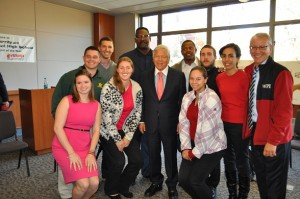 Robert Kraft, center, former New England Patriots Willie McGinest and Troy Brown rear center, and Tahar El-Korchi, right, with MQP students.