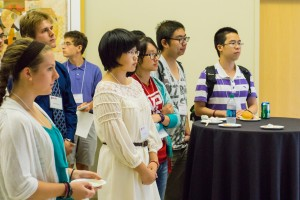 Huilin Yang, center, one of six Charles O. Thompson essay finalists, listens to remarks during the recognition program.