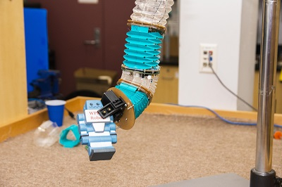 The soft manipulator robot can pick up and place objects.