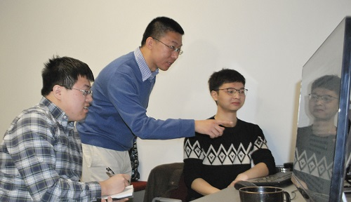 WPI professor Yanhua Li (center) with PhD students