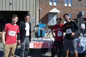 Thane Hunt, Professor Marko Popovic, Daniel Fitzgerald, and Andrés Leiro with Hydro Dog at the Vecna Race.
