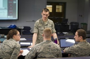 Air Force ROTC Cadet Mark Andraka confers with team members Brittany Kyer, Brian Gasco and Miles Schuler during a cybersecurity exercise that enlisted the expertise of the Air Force Research Lab in Rome, N.Y. and the 102nd Intelligence Wing at Otis Air National Guard Base on Cape Cod.