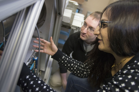 Applied Physics PhD Degree - WPI Students working on a machine