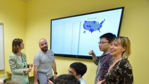 Students under the direction of Professor Elke Rundensteiner, right, developed a data analytics system that could help shape economic policy in Massachusetts.