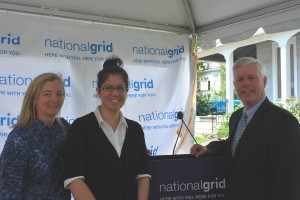 WPI student Mai Tomida, center, with National Grid president Marcy Reed and Massachusetts Secretary of Energy Richard Sullivan at an event to celebrate the utility company's Sustainability Hub, where Tomida and other students will educate the public on National Grid's smart grid pilot project.