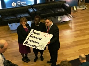 Suzanne Sontgerath on stage with Employment and Learning Minister Stephen Farry and Yvonne Spicer of the Boston Museum of Science.