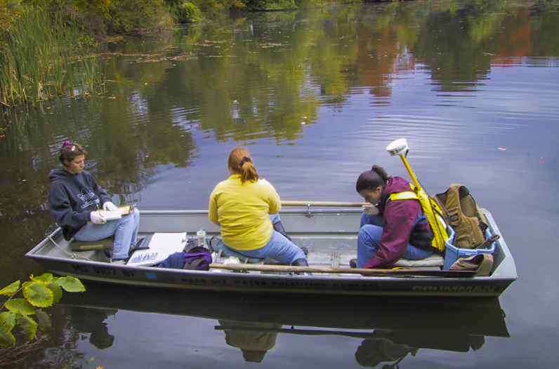 environmental engineering students in a boat
